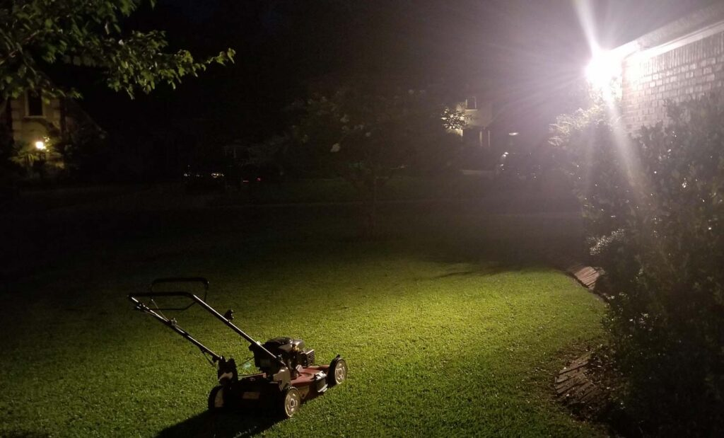 Mowing lawn at night